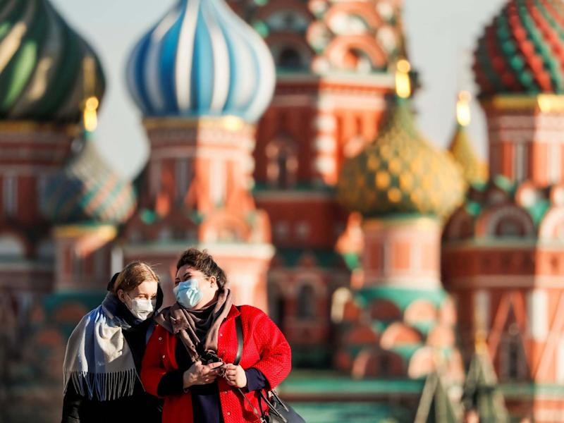 Women with protective masks walk across Red Square in Moscow: REUTERS