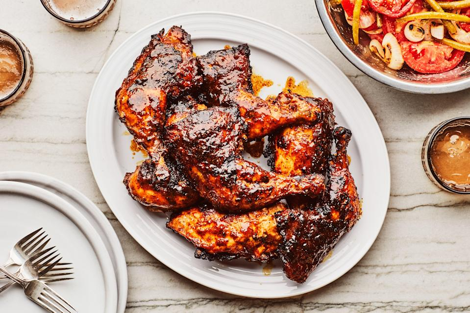 "For this cookout-ready diner, grilled chicken gets glazed with a sweet and tangy South Carolina–ish barbecue sauce. The simple salad of grilled onions, raw tomatoes, and pickled green beans provides a bright counterpart to the chicken's smoky char. <a href=""https://www.epicurious.com/recipes/food/views/grilled-chicken-with-mustard-barbecue-sauce-and-tomato-salad?mbid=synd_yahoo_rss"" rel=""nofollow noopener"" target=""_blank"" data-ylk=""slk:See recipe."" class=""link rapid-noclick-resp"">See recipe.</a>"