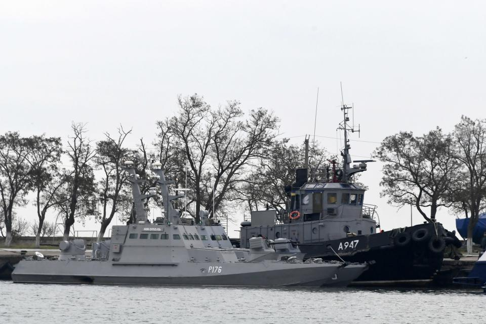 FILE - In this Monday, Nov. 26, 2018 file photo, three Ukrainian ships are docked near the Kerch after been seized on Sunday, in Kerch, Crimea. A U.N. maritime tribunal has ruled that Russia must release three Ukrainian naval vessels captured by Russia in November and release 24 detained sailors. The Hamburg-based International Tribunal for the Law of the Sea delivered its verdict Saturday, May 25, 2019 on the case Ukraine brought against Russia. (AP Photo, File)