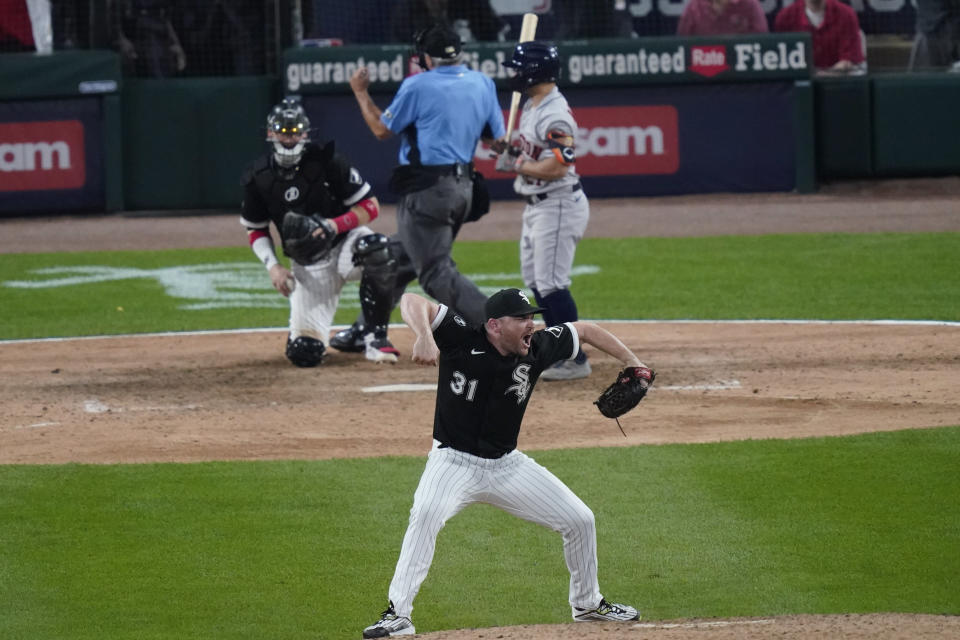 Chicago White Sox relief pitcher Liam Hendriks reacts to the final out against the Houston Astros in the ninth inning during Game 3 of a baseball American League Division Series Sunday, Oct. 10, 2021, in Chicago. (AP Photo/Charles Rex Arbogast)