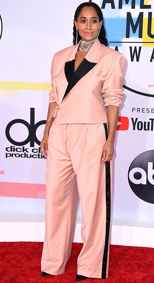 <p>She wore a pink two piece suit by Pyer Moss with Christian Louboutin pumps plus a lot of jewellery: a Jacob & Co necklace, one Djula Jewelry earring and one Matta Cielo earring. [Photo: Getty] </p>