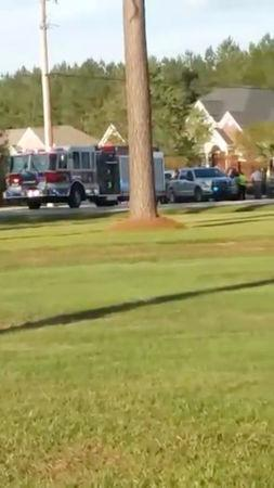 Emergency personnel are seen on site in the aftermath of a shooting in Florence, South Carolina, U.S. October 3, 2018, in this still image obtained from a social media video.  Derek Lowe/via REUTERS