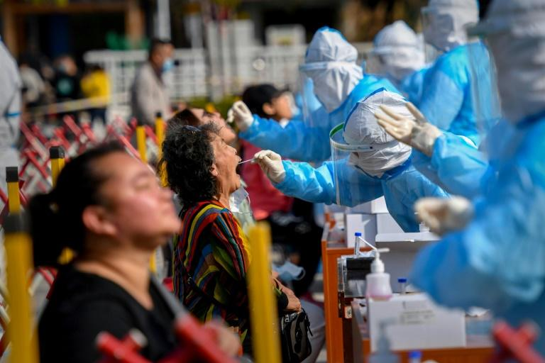 China tests entire city for virus as WHO slams herd immunity idea