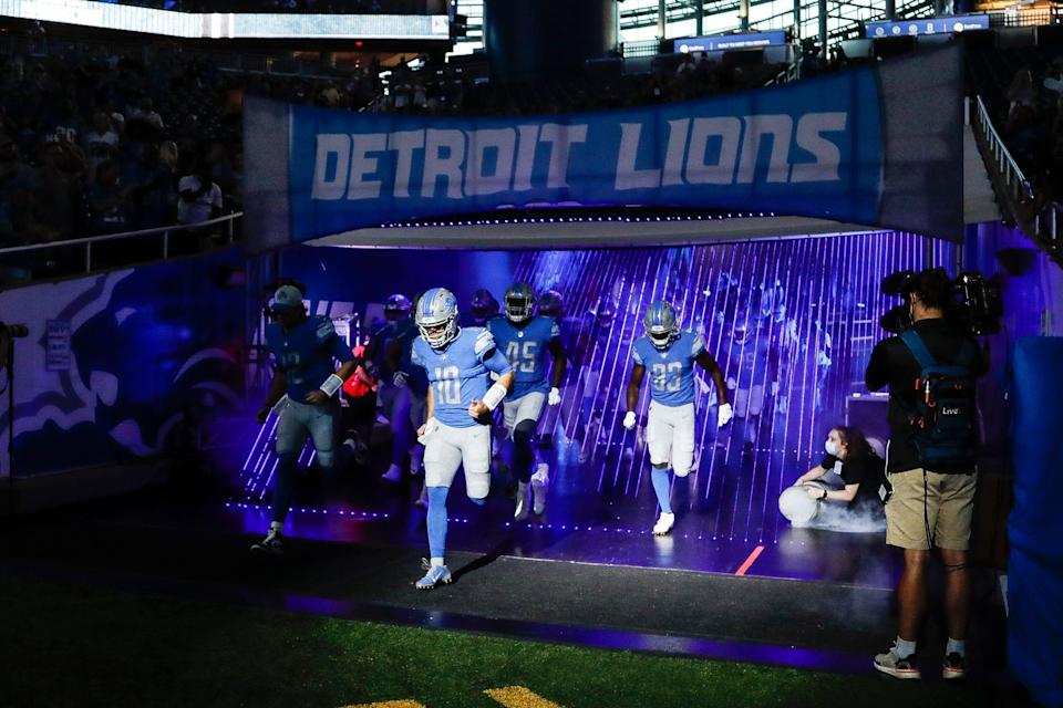 Detroit Lions quarterback David Blough (10) and teammates take the field before the first half of a preseason game at Ford Field in Detroit on Friday, Aug. 27, 2021.