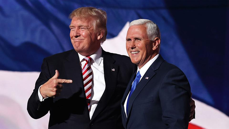 Donald Trump smiles and points to Mike Pence during a campaign.