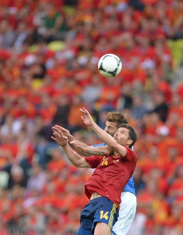 Spanish midfielder Xabi Alonso (Front) vies during the Euro 2012 championships football match Spain vs Italy on June 10, 2012 at the Gdansk Arena. The game ended in a draw 1-1. AFPPHOTO/ GIUSEPPE CACACEGIUSEPPE CACACE/AFP/GettyImages