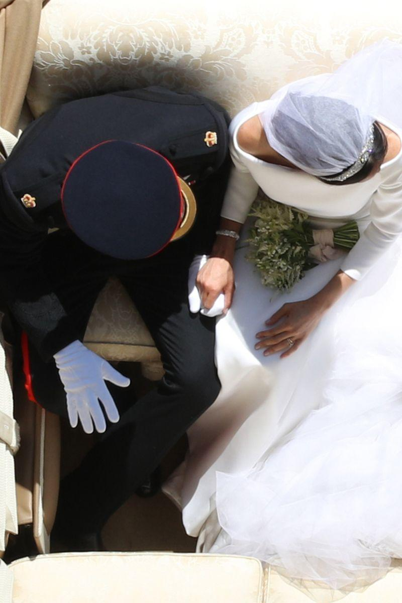 <p>An aerial shot captures the newlyweds holding hands after the ceremony.</p>