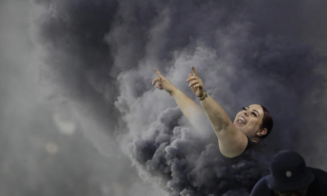 A Los Angeles FC fan cheers during the first half of the team's MLS soccer match against the San Jose Earthquakes on Wednesday, Aug. 21, 2019, in Los Angeles. (AP Photo/Marcio Jose Sanchez)