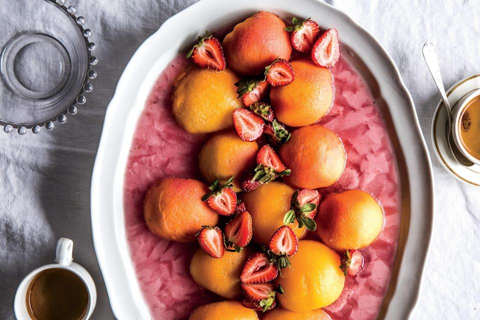 """Poached frozen peaches eat like fruit-shaped sorbet and look like a three-dimensional sunset. <a href=""""https://www.epicurious.com/recipes/food/views/frozen-peaches-with-strawberries-and-mint?mbid=synd_yahoo_rss"""" rel=""""nofollow noopener"""" target=""""_blank"""" data-ylk=""""slk:See recipe."""" class=""""link rapid-noclick-resp"""">See recipe.</a>"""