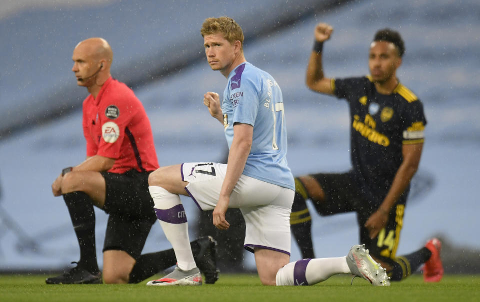 MANCHESTER, ENGLAND - JUNE 17: Kevin De Bruyne of Manchester City takes a knee in support of the Black Lives Matter movement prior to the Premier League match between Manchester City and Arsenal FC at Etihad Stadium on June 17, 2020 in Manchester, United Kingdom. (Photo by Peter Powell/Pool via Getty Images)