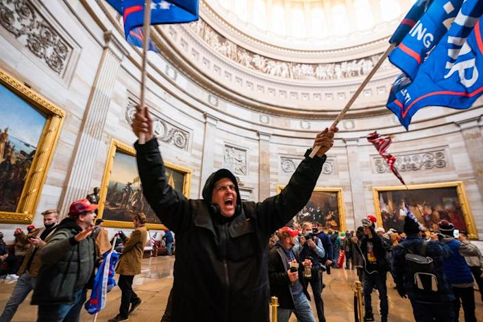 Pro-Trump mob in the Capitol Rotunda after breaching Capitol security on 6 January.
