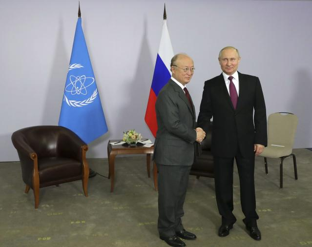 Russian President Vladimir Putin shakes hands with International Atomic Energy Agency (IAEA) Director General Yukiya Amano during their meeting in Sochi, Russia May 14, 2018. Sputnik/Mikhail Klimentyev/Kremlin via REUTERS ATTENTION EDITORS - THIS IMAGE WAS PROVIDED BY A THIRD PARTY.