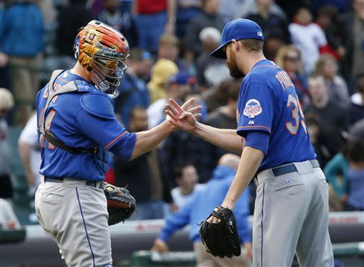 New York Mets catcher John Buck, left, and relief pitcher Bobby Parnell celebrate a 3-2 win over the Chicago Cubs after a baseball game on Friday, May 17 2013, in Chicago. (AP Photo/Charles Rex Arbogast)