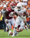 FILE - In this Oct. 6, 2018, file photo, Texas running back Keaontay Ingram (26) breaks free against Oklahoma during the second half of an NCAA college football game at the Cotton Bowl in Dallas. No. 5 Oklahoma and No. 9 Texas are playing in a rare Red River rivalry rematch in the Big 12 championship game on Saturday. It is the first time in 115 years that the border state rivals will play twice in the same season. (AP Photo/Cooper Neill, File)