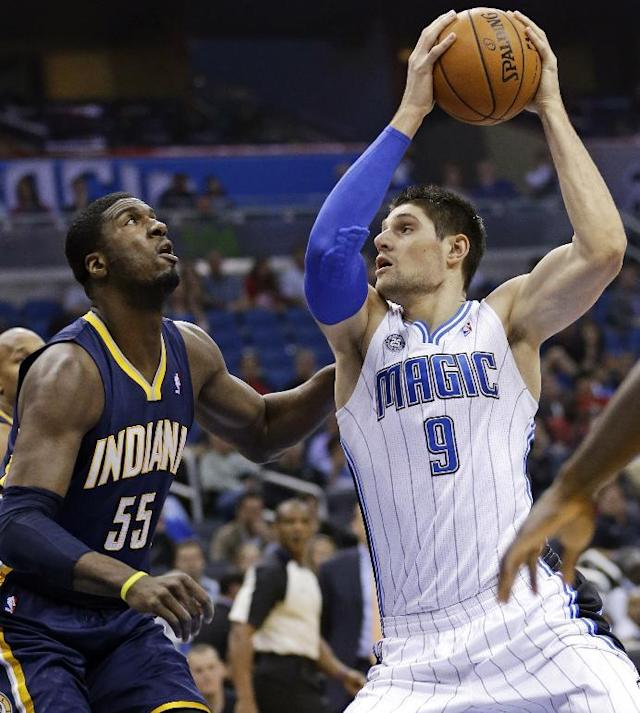 Orlando Magic's Nikola Vucevic (9), of Montenegro, looks for an open lane around Indiana Pacers' Roy Hibbert (55) during the first half of an NBA basketball game in Orlando, Fla., Sunday, Feb. 9, 2014. (AP Photo/John Raoux)
