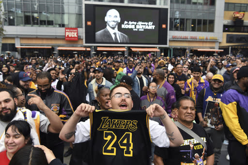 Gabriel Rivas, front, chants outside Staples Center at a memorial for Laker legend Kobe Bryant Sunday, Jan. 26, 2020, in Los Angeles. Bryant, the 18-time NBA All-Star who won five championships and became one of the greatest basketball players of his generation during a 20-year career with the Los Angeles Lakers, died in a helicopter crash Sunday. (AP Photo/Michael Owen Baker)