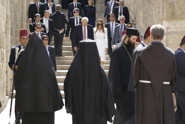 <p>U.S. President Donald Trump, center left and first lady Melania visit the Church of the Holy Sepulchre, in Jerusalem, Monday, May 22, 2017. Trump opened his first visit to Israel Monday, a two-day stop aimed at testing the waters for jumpstarting the dormant Middle East peace process. (AP Photo/Evan Vucci) </p>