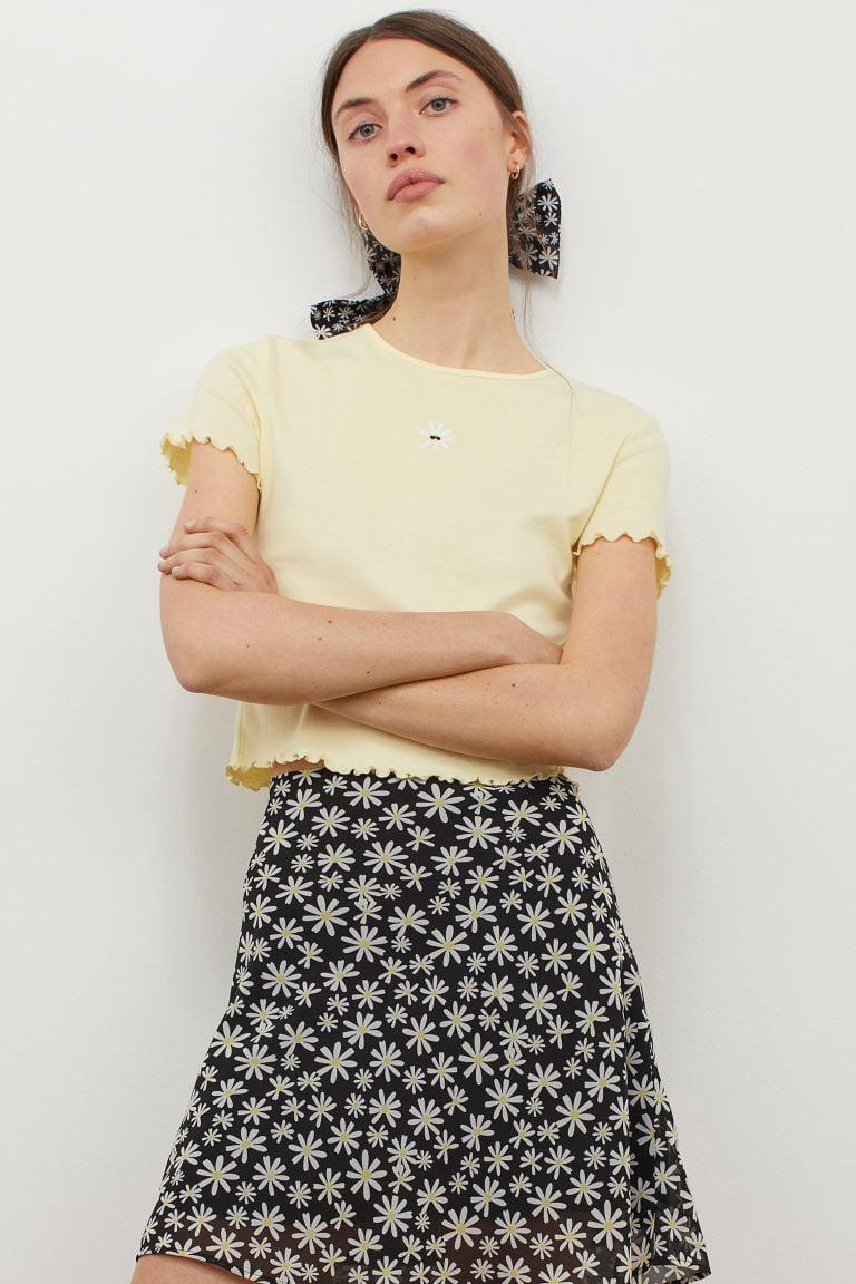 <p>You can rock the <span>To All the Boys I've Loved Before x H&amp;M Short-sleeved Top</span> ($13) with a cute skirt, with a comfy pair of mom jeans, and even layered with a demin jacket.</p>