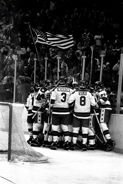 FILE - In this Feb. 22, 1980, file photo, U.S. ice hockey players celebrate after a first period goal by Buzz Schneider against the Soviet Union at the Winter Olympics in Lake Placid, N.Y.  (AP Photo/File)