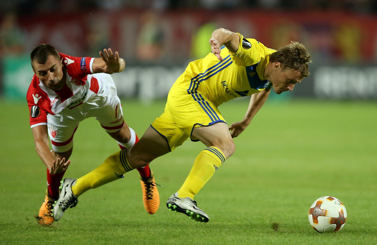 Soccer Football - Europa League - Crvena Zvezda vs BATE Borisov - Rajko Mitic Stadium, Belgrade, Serbia - September 14, 2017   Crvena Zvezda's Nenad Krsticic in action with BATE Borisov's Vitali Rodionov    REUTERS/Marko Djurica