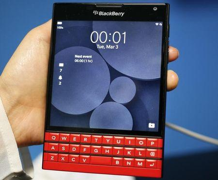 A man displays the new Blackberry Passport smartphone during the Mobile World Congress in Barcelona