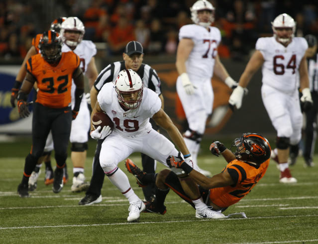 Stanford wide receiver JJ Arcega-Whiteside sheds an Oregon State defender during the first half of an NCAA college football game, in Corvallis, Ore., Thursday, Oct. 26, 2017. (AP Photo/Timothy J. Gonzalez)
