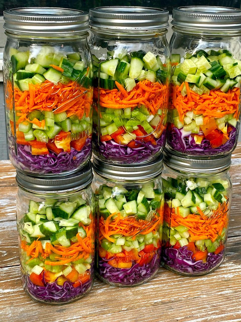 <p>If you want to pack salads that will last more than five days, make sure your veggies are as dry as possible when you add them to the jar, and layer them so that the wettest veggies (like cucumbers) are on top. This is key to keeping them crisp!</p> <p>For absolute freshness that lasts on days five through seven, don't add the dressing or other wet ingredients like beans, fruit, tomatoes, roasted veggies, or whole grains - add those to your salad bowl on the day you eat it. And keep your greens separate - more on that in the next slide!</p>