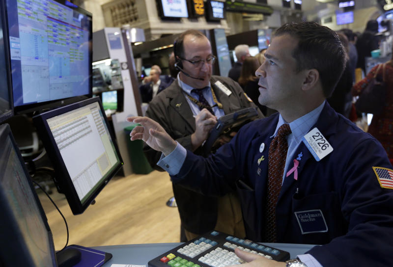 Specialist Paul Cosentino, right, works at his post on the floor of the New York Stock Exchange Friday, Nov. 22, 2013. Stocks were mixed in early trading Friday as traders and investors lacked a catalyst to push the major indexes higher after strong gains this year. (AP Photo/Richard Drew)