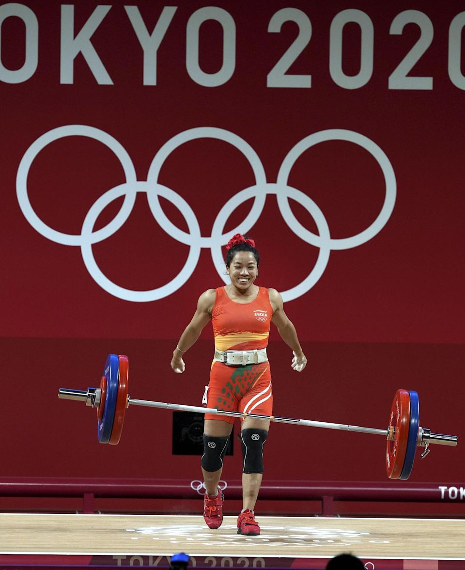 """<div class=""""paragraphs""""><p>India's Mirabai Chanu reacts during her unsuccessful last attempt at the Snatch event of Weightlifting in Tokyo, Saturday, July 24, 2021.</p></div>"""