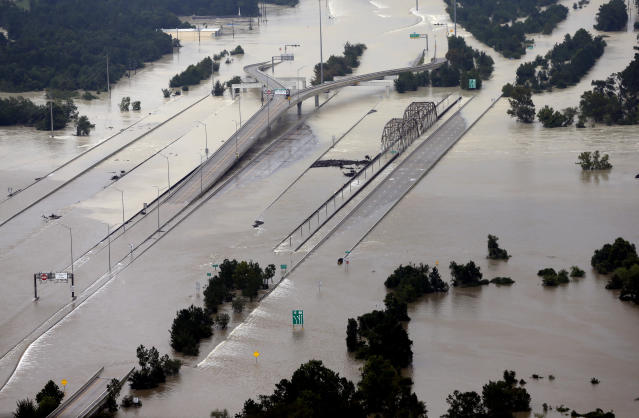 "<span class=""s1"">Interstate 69 is covered by water at the San Jacinto River bridge in Humble, Texas, on Aug. 29. (Photo: David J. Phillip/AP)</span>"