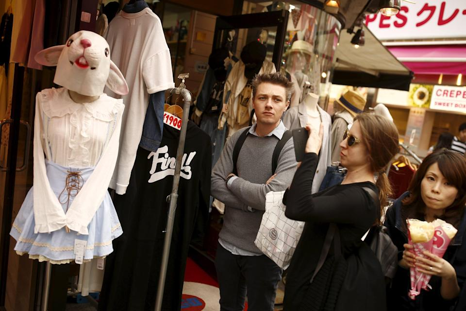 A woman takes a pictures of a mannequin wearing a rabbit mask in the Harajuku district of Tokyo, which is popular among tourists, in Japan, March 30, 2016. The Japan tourist tax will add an extra element to each trip. (Photo: REUTERS/Thomas Peter)