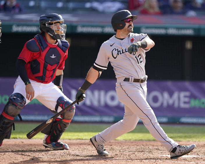 Chicago White Sox's Adam Eaton, right, watches his two-run home run in the eighth inning of the first baseball game of a doubleheader against the Cleveland Indians, Monday, May 31, 2021, in Cleveland. Indians catcher Rene Rivera, left, also watches the hit. (AP Photo/Tony Dejak)