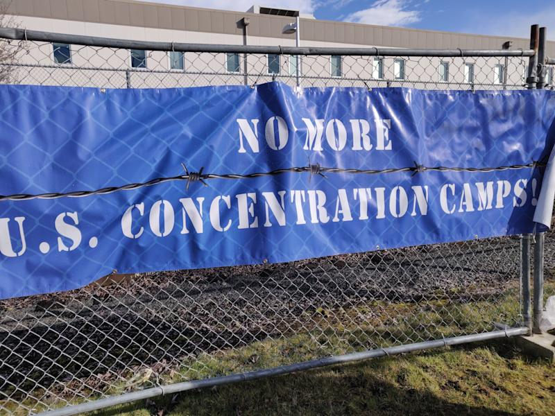 A sign outside the Northwest Detention Center in Tacoma, Washington, bluntly summarized the message of Sunday's demonstration. (Photo: Mari Hayman/HuffPost)