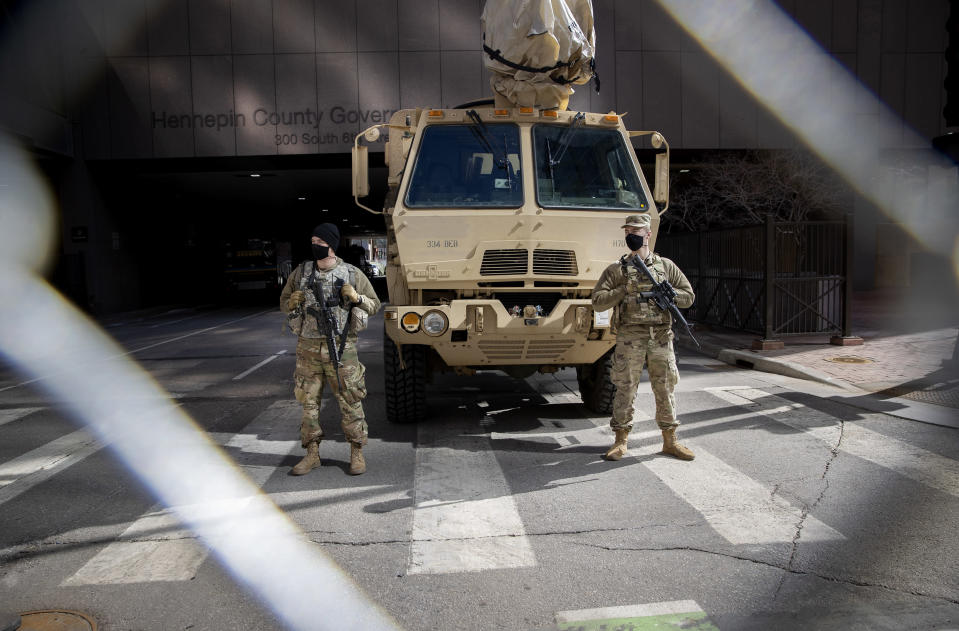 The military stands guard outside the Hennepin County Government Center during the first day of the Derek Chauvin trial, Monday, March 8, 2021, in Minneapolis, Minn. (Elizabeth Flores/Star Tribune via AP)