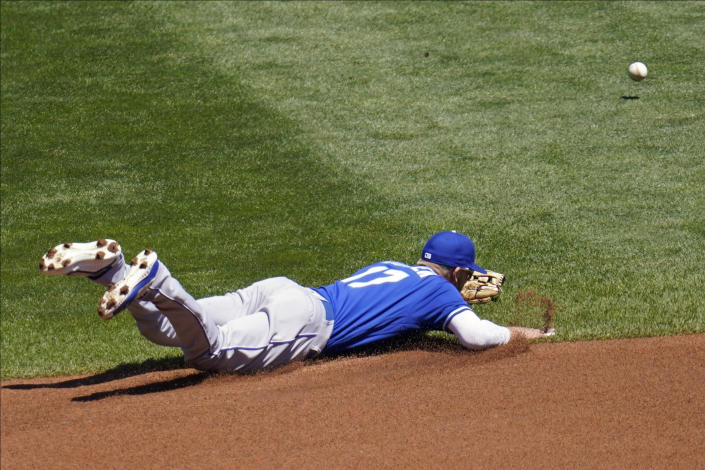 A grounder by Minnesota Twins' Josh Donaldson gets by Kansas City Royals third baseman Hunter Dozier (17) for a single in the first inning of a baseball game, Saturday, May 29, 2021, in Minneapolis. (AP Photo/Jim Mone)