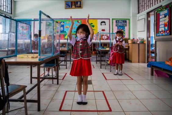 Pupils stand in socially distanced boxes that are marked out in a classroom at Wat Khlong Toey School in Bangkok, Thailand, on August 10, 2020. (Lauren DeCicca/Getty Images )