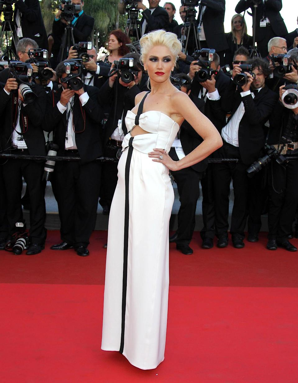 <p>The black-and-white color palette toughened up the look of the Giorgio Armani dress Gwen wore to Cannes in 2011.</p>