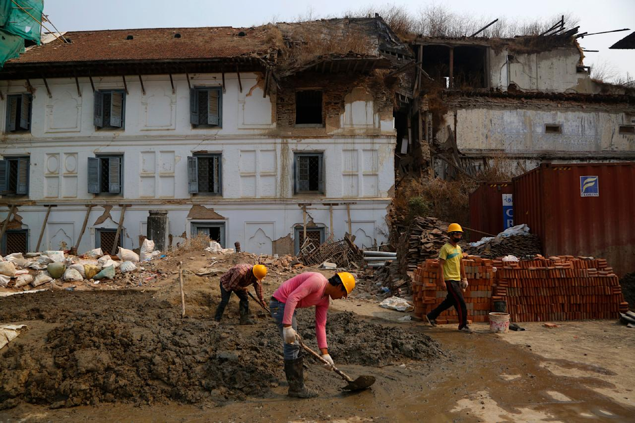 Nepalese men work on reconstruction of a site damaged by the 2015 earthquake at Basantapur Durbar square during the third anniversary of the earthquake in Kathmandu, Nepal, Wednesday, April 25, 2018. The violence of the 7.8-magnitude earthquake killed nearly 9,000 people and left countless towns and villages across central Nepal in shambles. (AP Photo/Niranjan Shrestha)