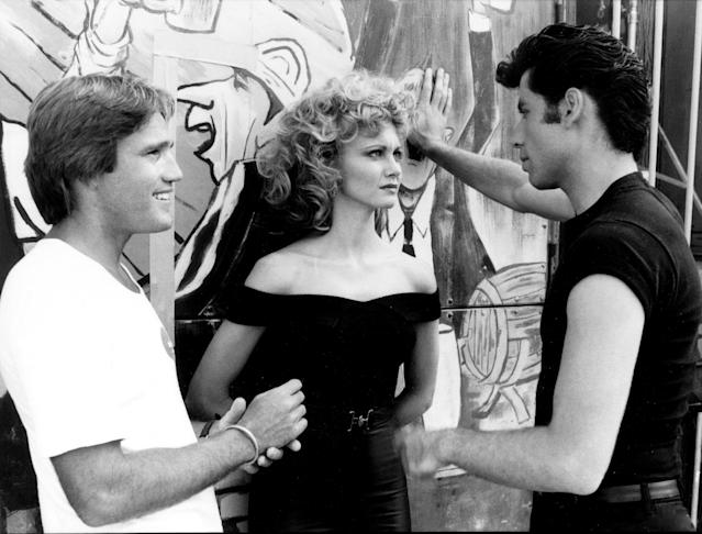 Director Randal Kleiser on the carnival set with Olivia Newton-John and John Travolta. (Photo: Paramount Pictures/courtesy of the Everett Collection)