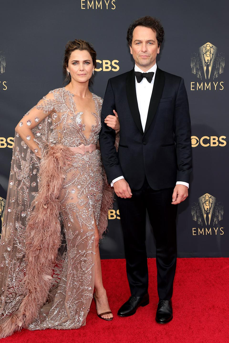Keri Russell wears a rose gold embellished gown and Matthew Rhys wears a tuxedo at the 73rd Primetime Emmy Awards at L.A. LIVE on September 19, 2021 in Los Angeles, California. (Photo by Rich Fury/Getty Images)