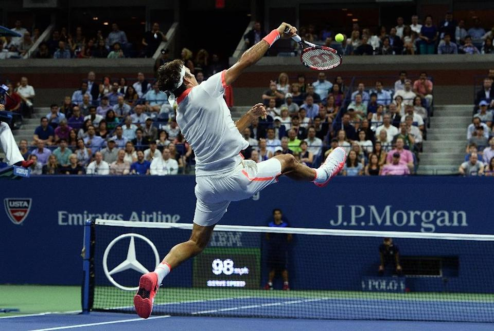 Roger Federer returns the ball to Stan Wawrinka during their 2015 US Open Men's singles semifinals match in New York on September 11, 2015 (AFP Photo/Jewel Samad)