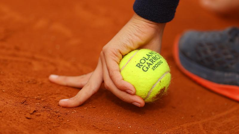 A ball kid, pictured here holding a tennis ball on day four of the 2020 French Open.