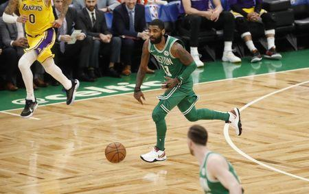 FILE PHOTO: Feb 7, 2019; Boston, MA, USA; Boston Celtics guard Kyrie Irving (11) returns the ball against the Los Angeles Lakers in the first quarter at TD Garden. Mandatory Credit: David Butler II-USA TODAY Sports
