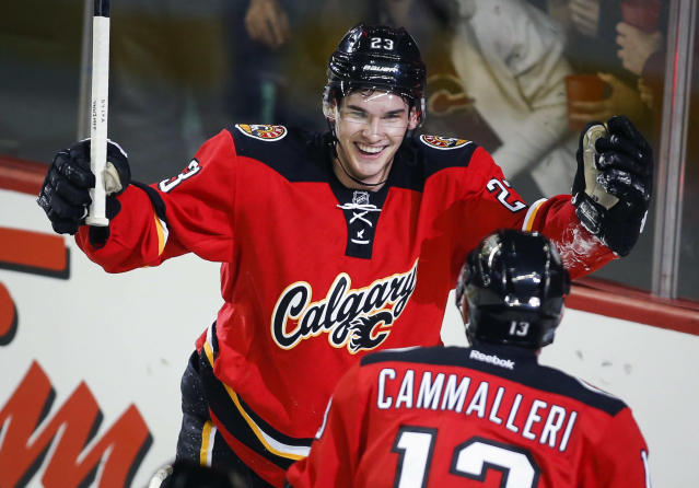 Calgary Flames' Sean Monahan, left, celebrates his goal with teammate Mike Cammalleri during the first period of an NHL hockey game Saturday, Nov. 16, 2013 in Calgary, Alberta. (AP Photo/The Canadian Press, Jeff McIntosh)