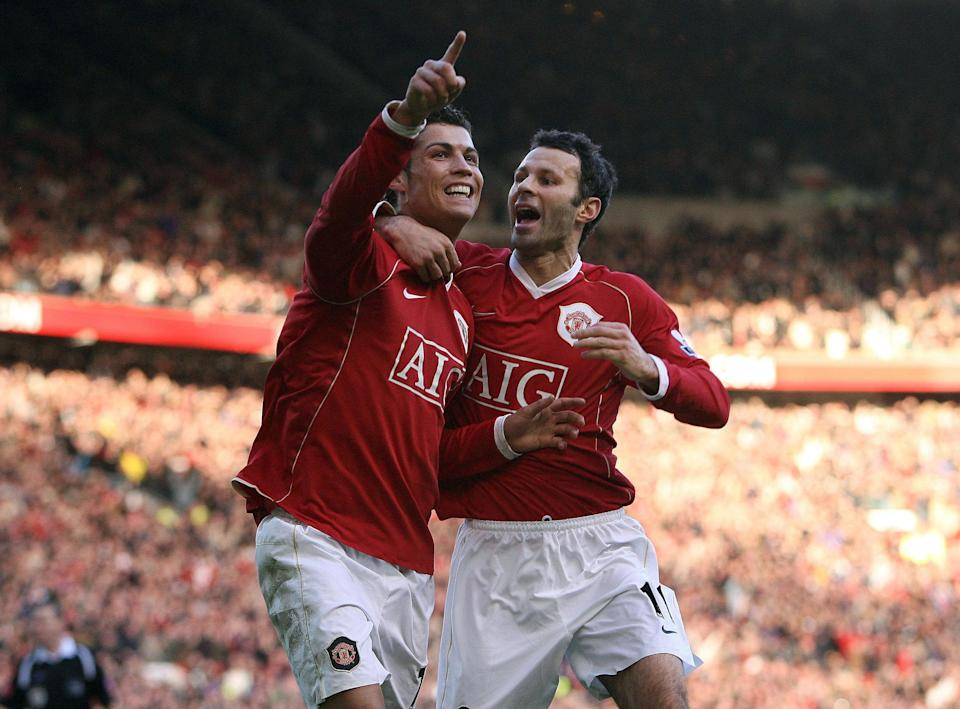 Manchester United's Cristiano Ronaldo (left) celebrates with Ryan Giggs after scoring during the Barclays Premiership match against Manchester City at Old Trafford, Manchester. (Photo by Martin Rickett - PA Images/PA Images via Getty Images)