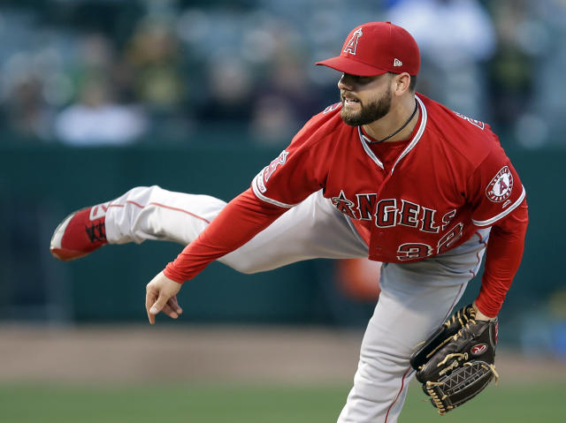 Los Angeles Angels pitcher Cam Bedrosian works against the Oakland Athletics in the first inning of a baseball game, Tuesday, May 28, 2019, in Oakland, Calif. (AP Photo/Ben Margot)