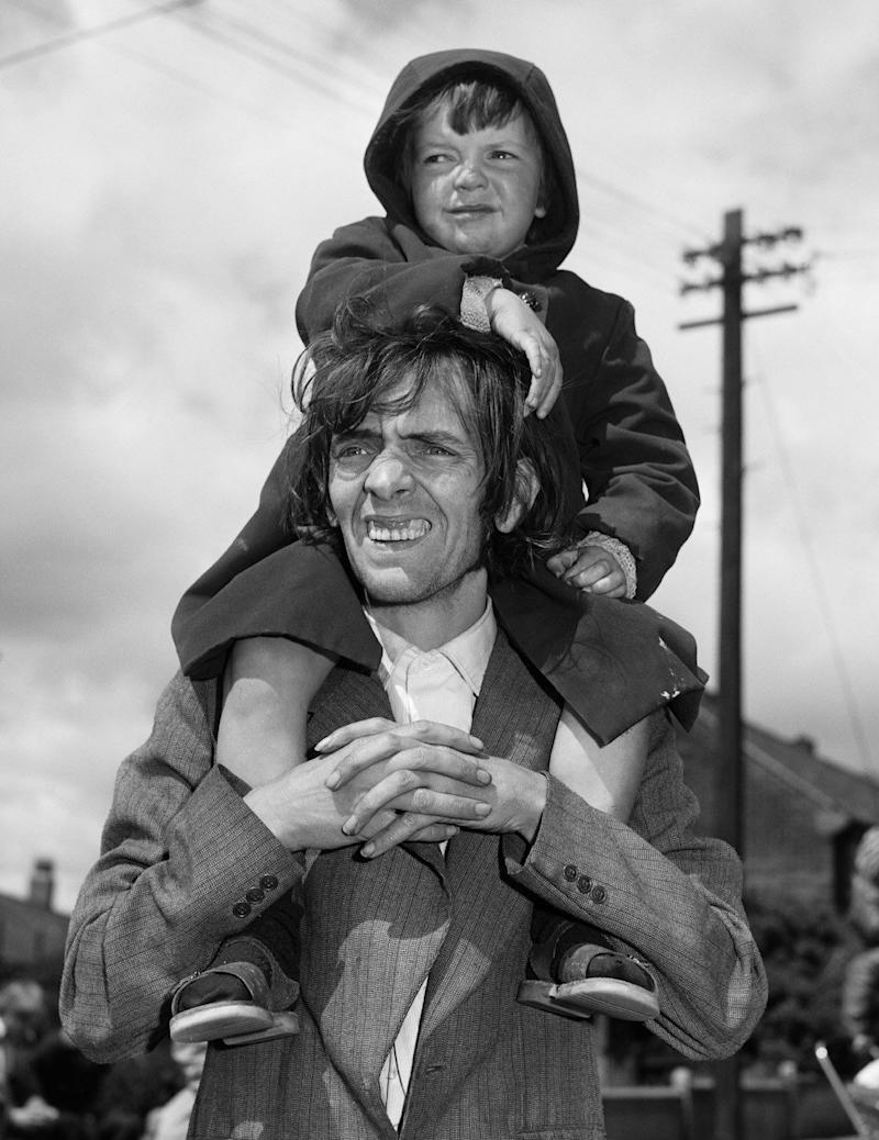 Father and son watching a parade, West End, Newcastle, 1980 - Chris Killip