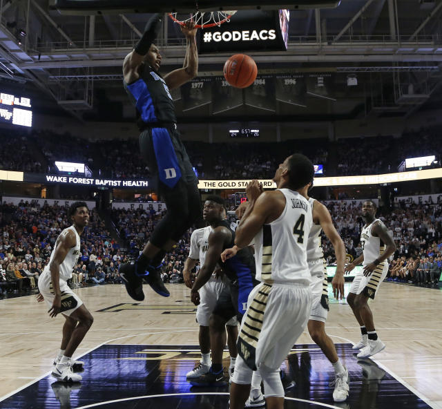 Duke's RJ Barrett (5) dunks against Wake Forest during the first half of an NCAA college basketball game in Winston-Salem, N.C., Tuesday, Jan. 8, 2019. (AP Photo/Chuck Burton)
