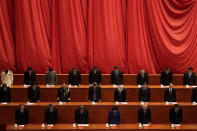 Party officials bow to pay condolences to the soldiers during the commemorating conference on the 70th anniversary of China's entry into the 1950-53 Korean War, at the Great Hall fo the People in Beijing, Friday, Oct. 23, 2020. (AP Photo/Andy Wong)
