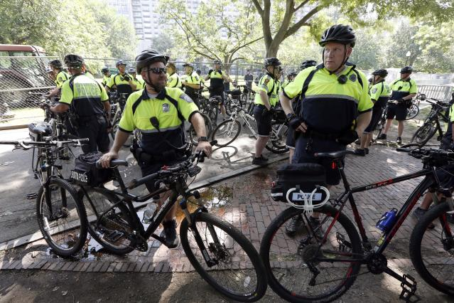 """<p>Police wait with their bicycles before a planned """"Free Speech"""" rally on Boston Common, Saturday, Aug. 19, 2017, in Boston. (Photo: Michael Dwyer/AP) </p>"""